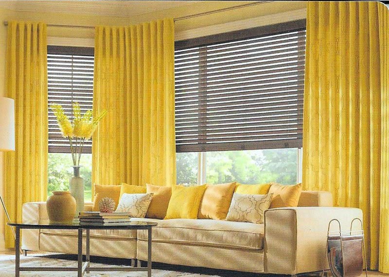 living room with bright yellow curtains